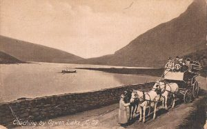 "Grosvenor Series postcard - ""Coaching by Ogwen Lake"""